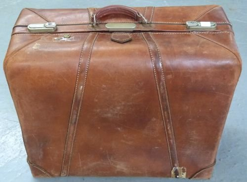 Gentleman's vintage leather folding suit carrier with f