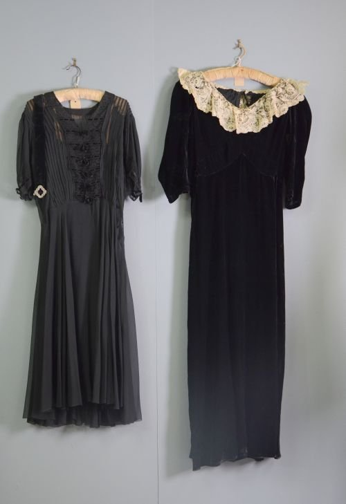 An Edwardian dress of black velvet with hand lace colla