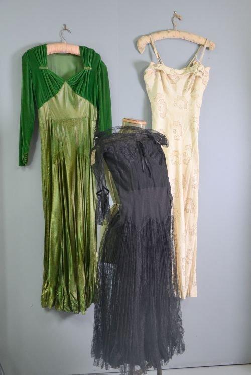 Three 1930's evening dresses. Emerald green velvet and