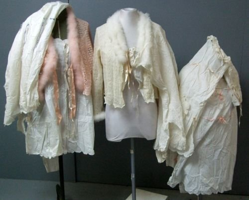 Five Edwardian cotton nightdresses with lace and ribbon