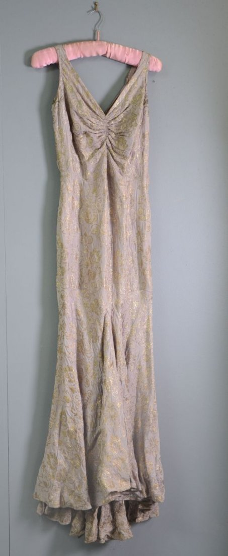 Evening dress of mauve brown brocaded in gold, matching