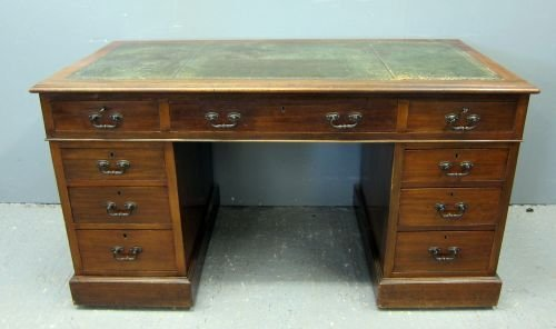 Mahogany pedestal desk with green leather inset top 29""