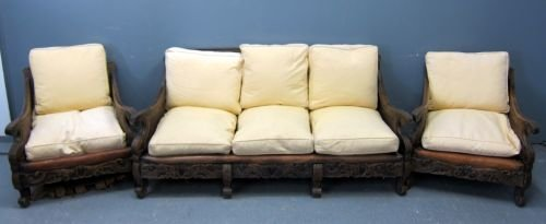 Bergere double panelled lounge suite with carved arms,