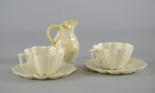 Pair of belleek cups and saucers Black stamp to base an