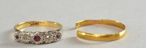Ruby and diamond illusion set five stone ring together