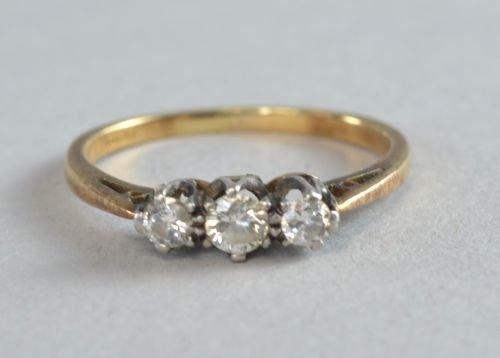 Three stone diamond ring stamped 18ct. Ring size J