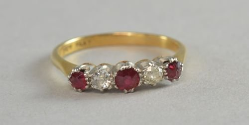 Five stone ruby and diamond ring stamped 18ct. and