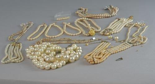 Twelve assorted imitation pearl necklaces