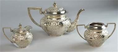Indian white metal three piece tea service comprising