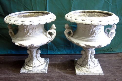 Pair of painted metal urns in 18th century manner,