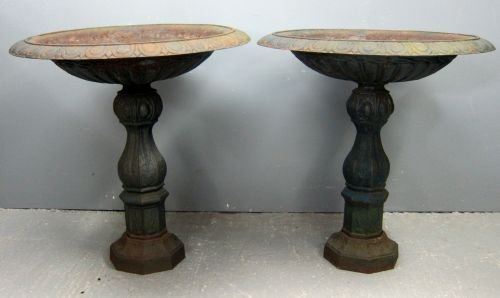 Pair of cast metal round fountains, on column supports