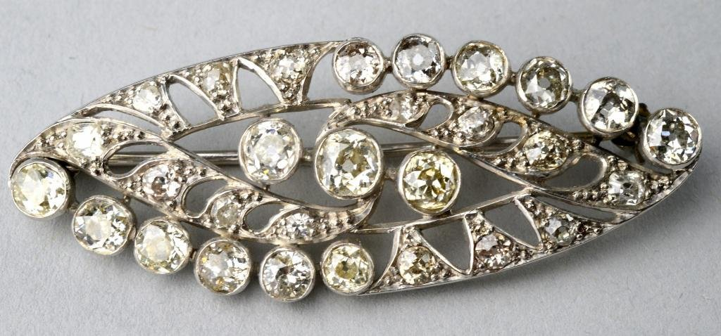 Oval open work diamond brooch containing Victorian cut