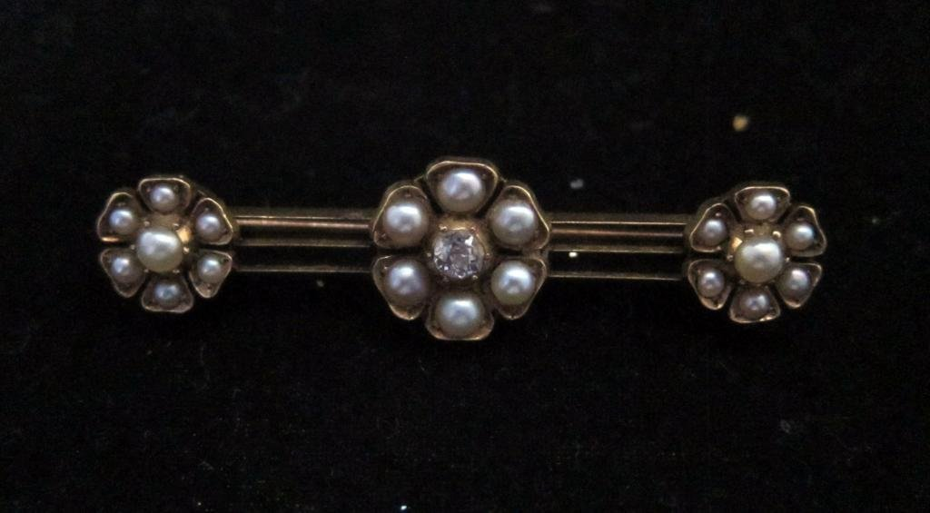 Victorian gold bar style brooch set with three