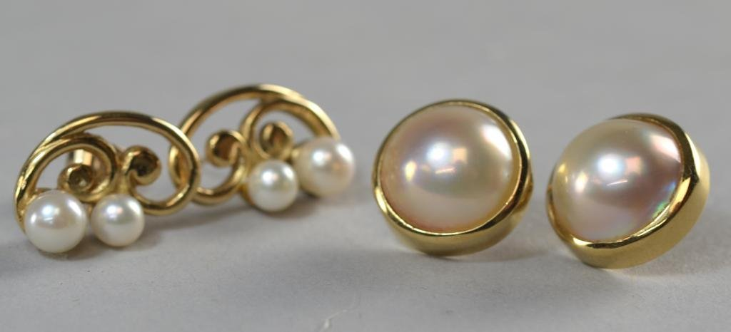 Two pairs of cultured pearl earrings comprising a pair