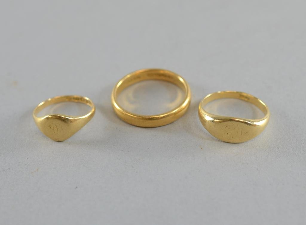 Gold wedding band 22ct and two 18ct gold signet rings,