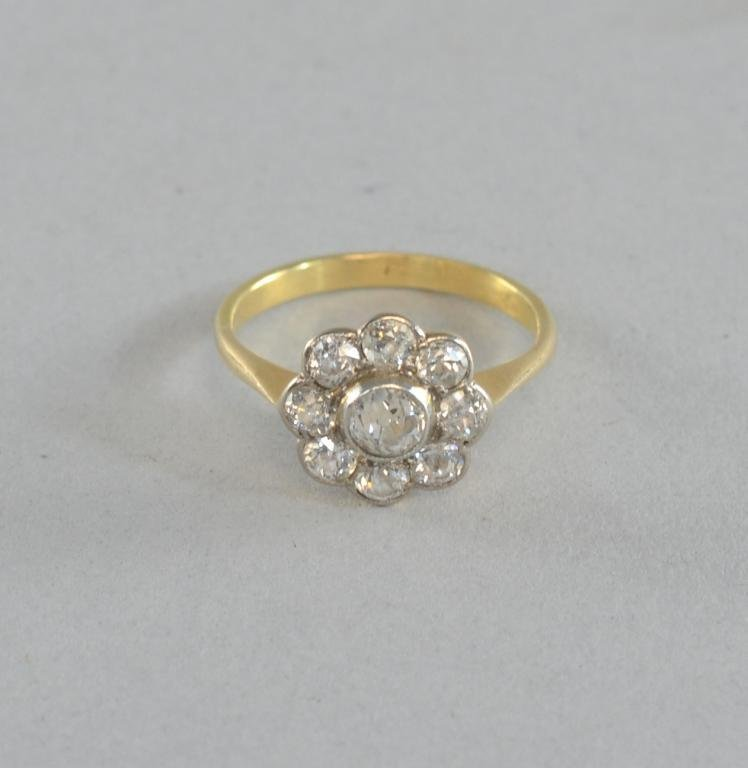 Edwardian diamond daisy cluster ring , set in unmarked