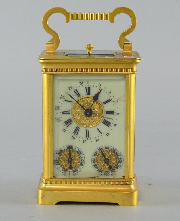 Brass and glass carriage clock with repeat with
