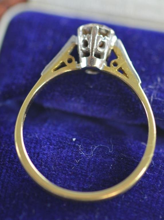 Solitaire diamond ring with old cut stone