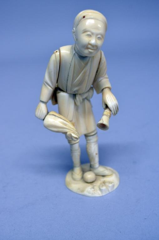 19th century Japanese Ivory figure of a man, signed on