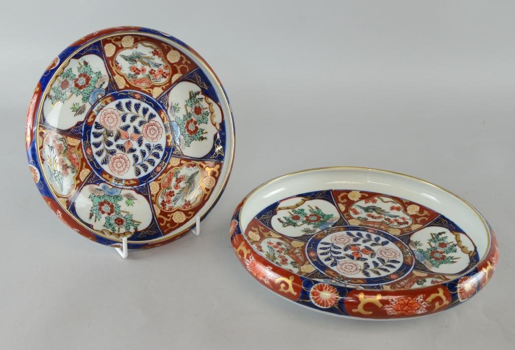 Two Japanese Imari dishes decorated in rust and floral