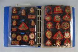 Three sets of Military cap badges insignia and a