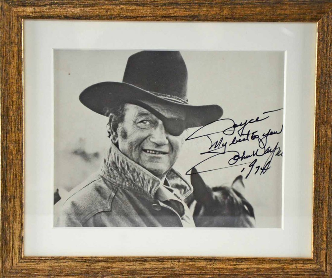 John Wayne, a signed black and white photograph of the