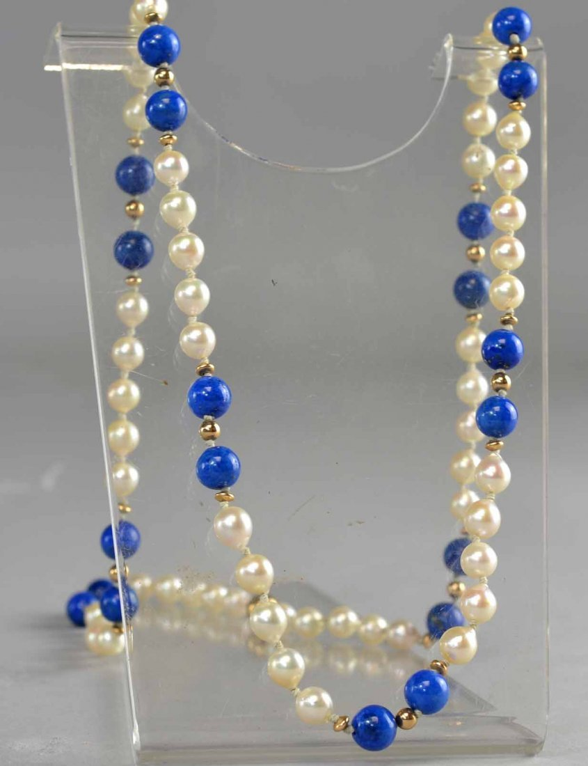 Lapis and cultured pearl necklace comprising sections