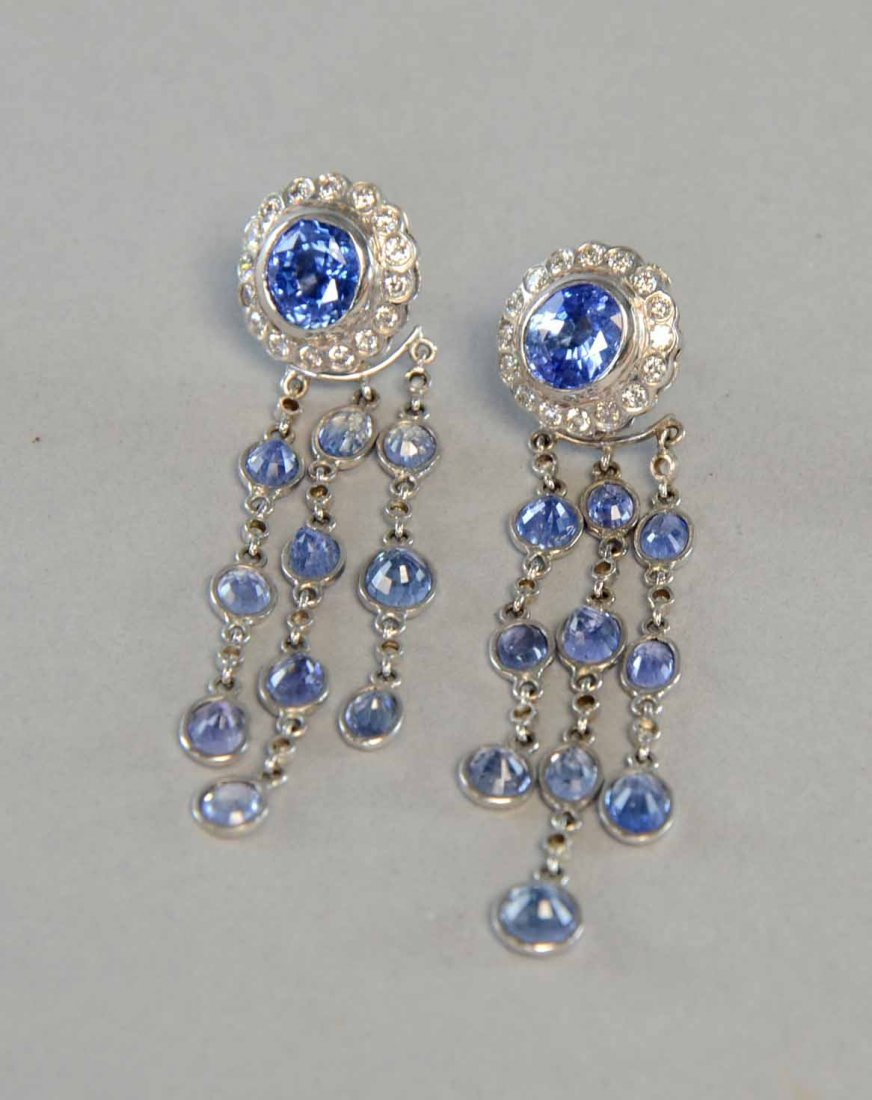 A pair of Sri Lankan sapphire earrings, oval cut with