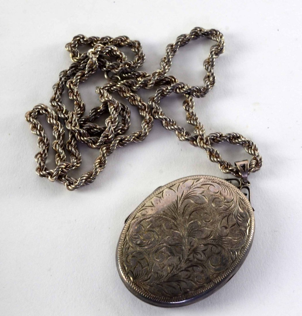 Large Victorian silver locket, engraved on the front