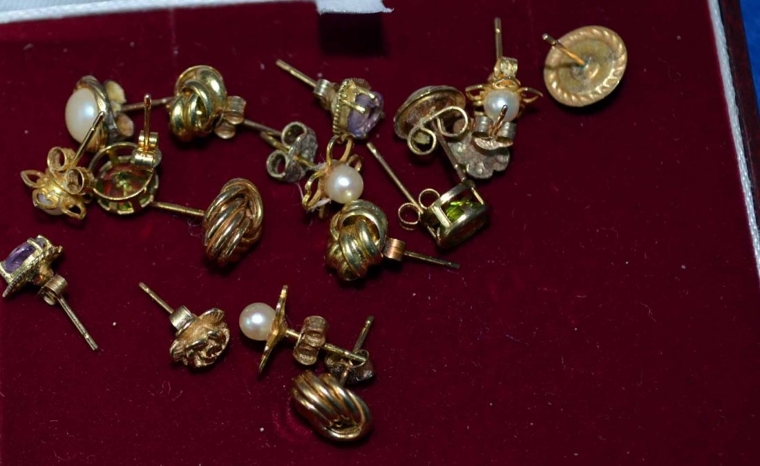 Nine pairs of 9ct gold stud earrings, including