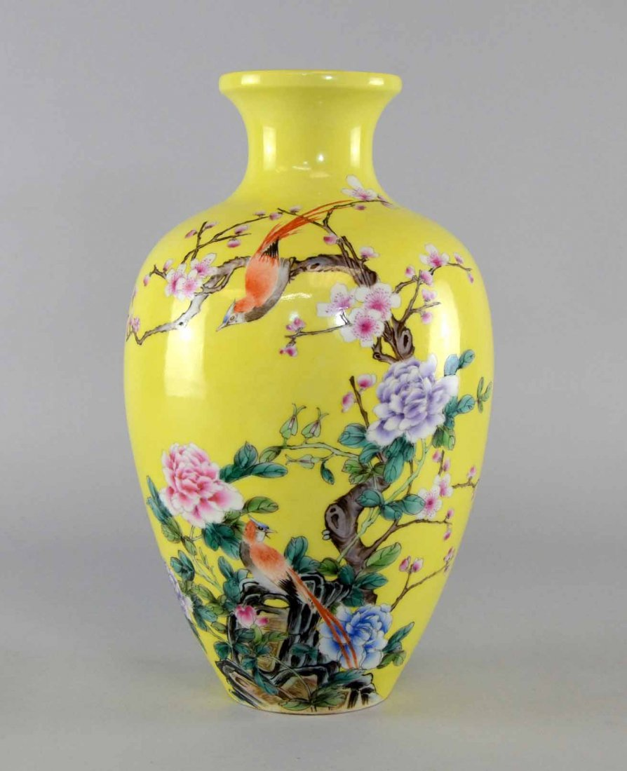 Chinese yellow glazed vase decorated with birds on