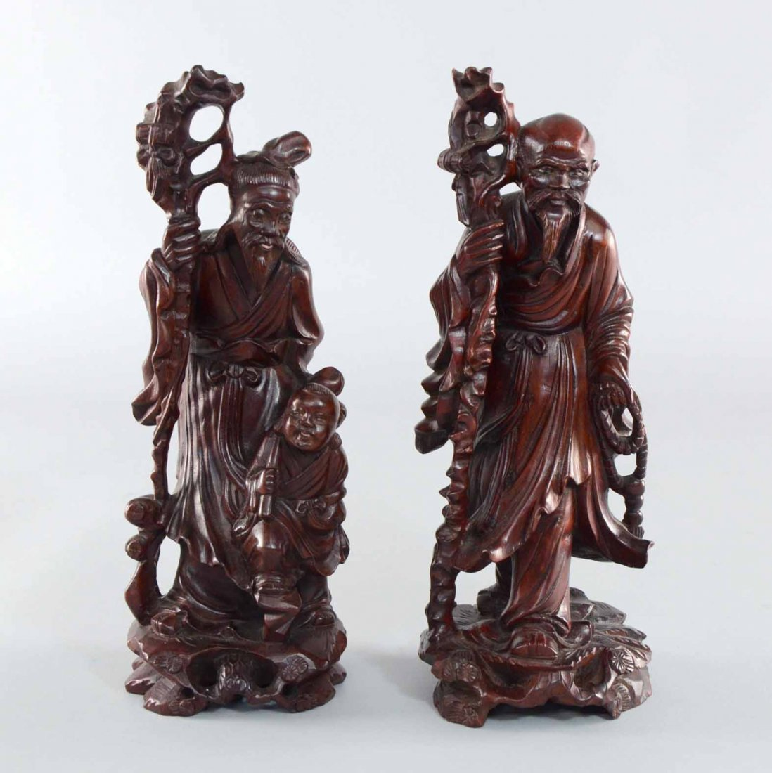 Two Chinese wood carvings of Immortals ,one accompanied