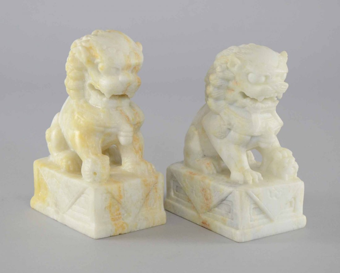 Pair of Chinese white stone carvings of dogs of Fo, the