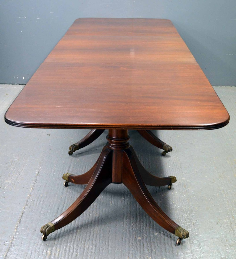 George III style mahogany three pillar dining table on