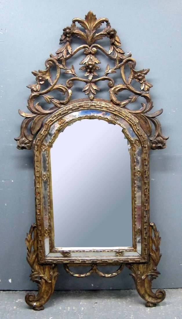 19th C carved giltwood mirror, the arched top with