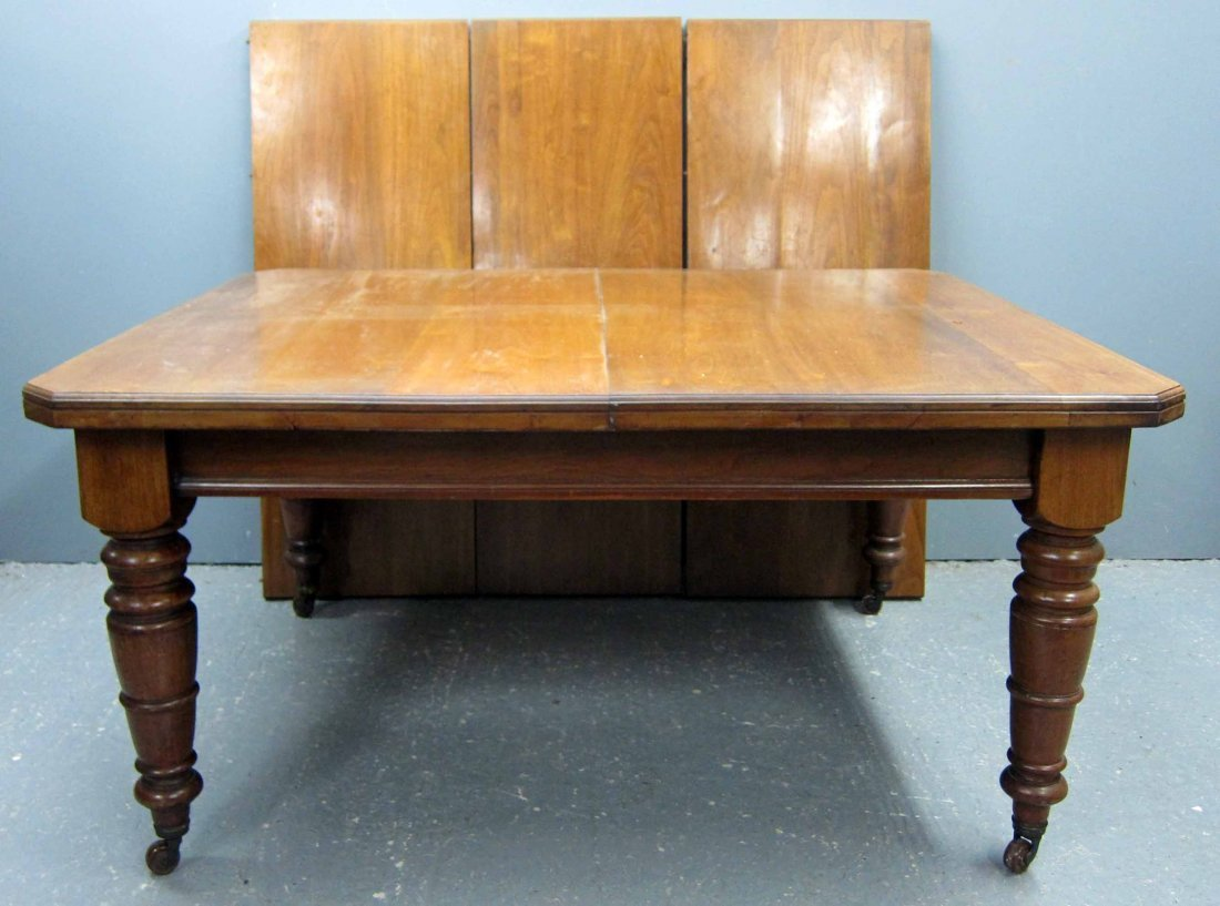 19th Century mahogany extending dining table with three
