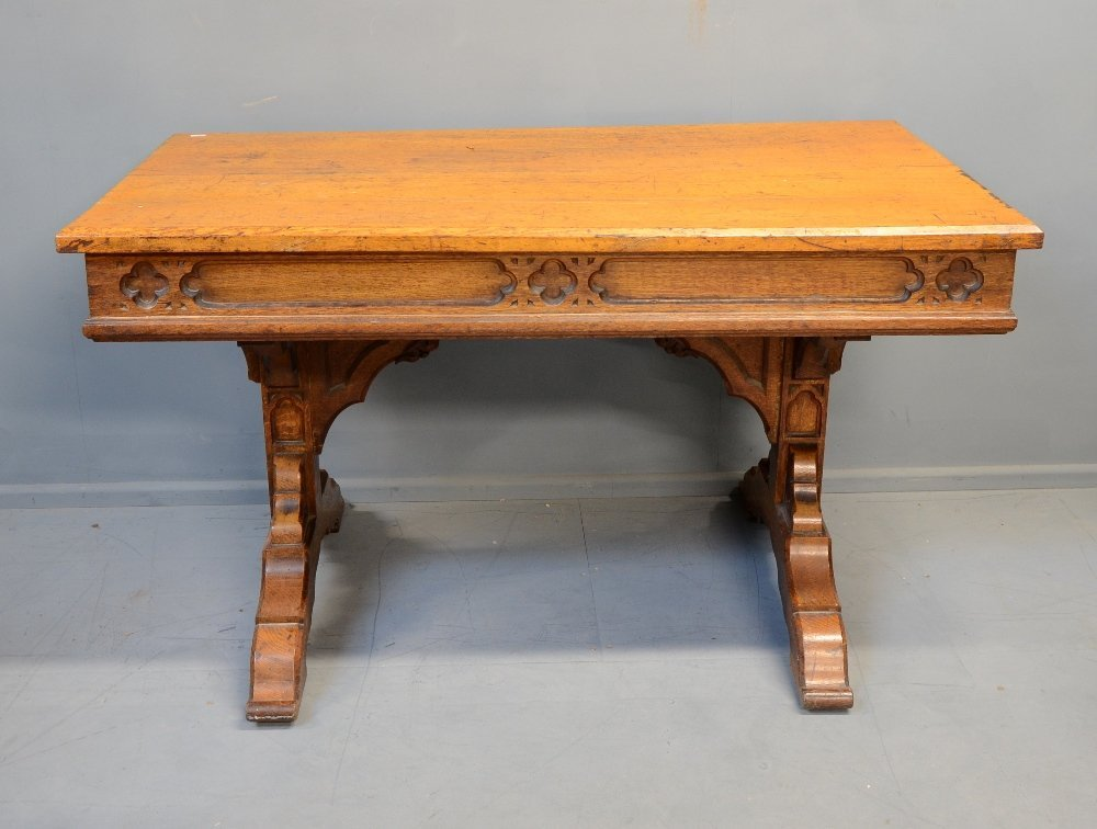 Oak Gothic Revival centre table on twin end supports