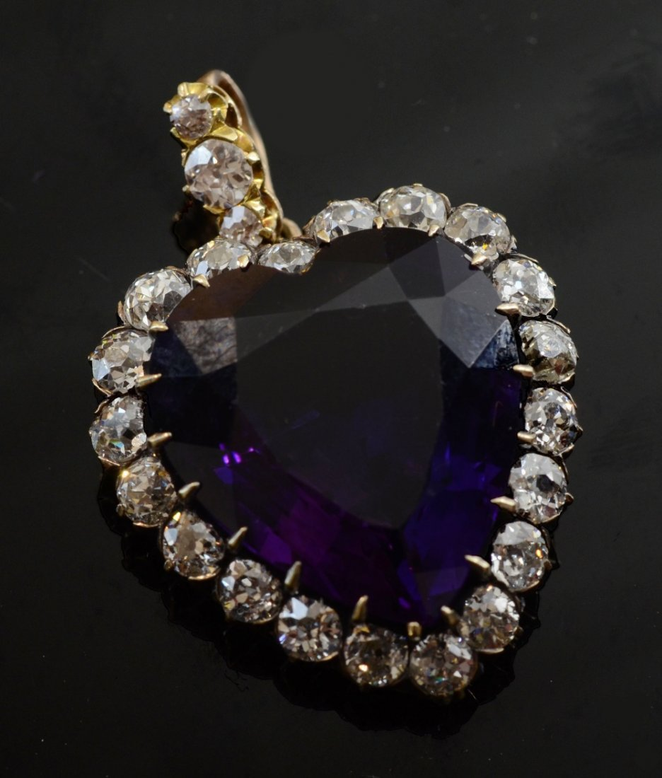 Heart shaped amethyst and diamond cluster pendant with