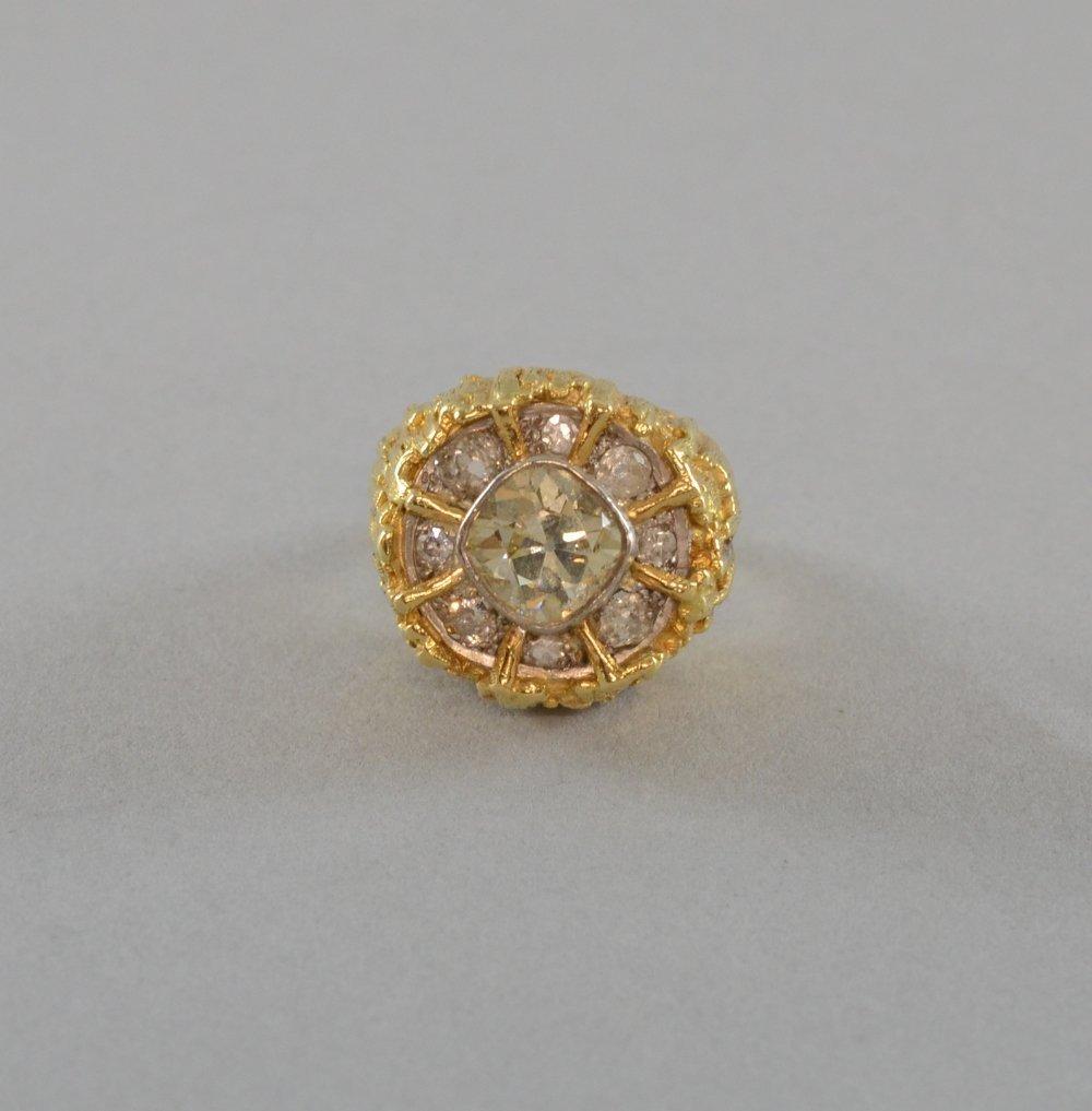 Fancy yellow diamond set ring, central diamond cushion