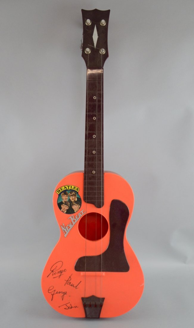 The Beatles, a boxed New Beat plastic guitar with
