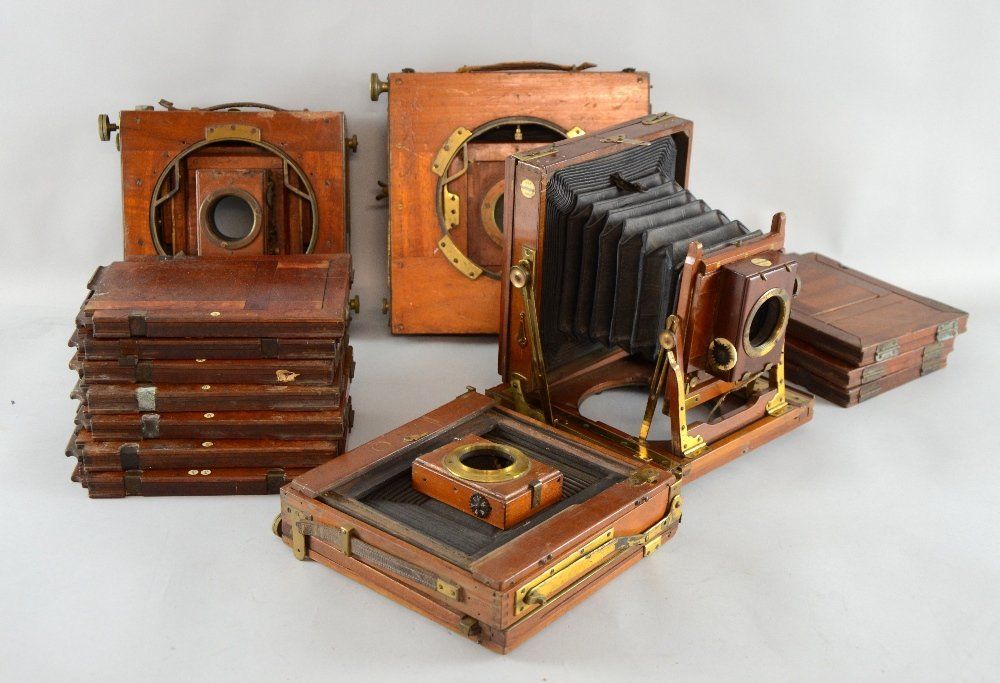 Four mahogany plate cameras, one marked The Sandringham