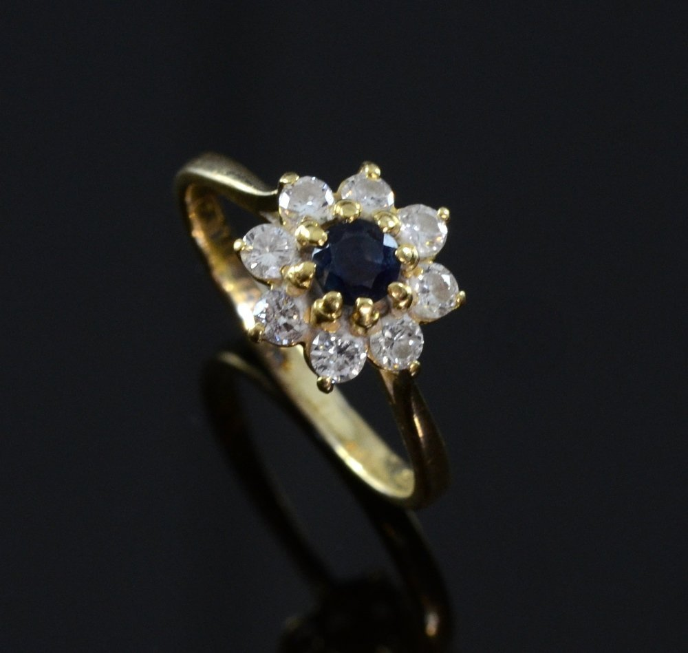 Diamond and sapphire ring in floral setting 18ct