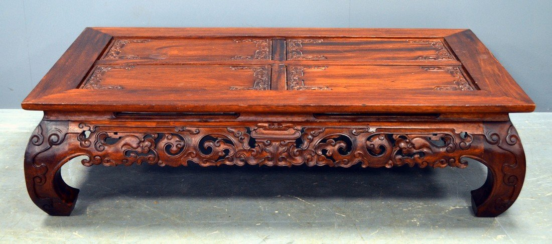 Chinese hardwood low table with carved frieze on shaped
