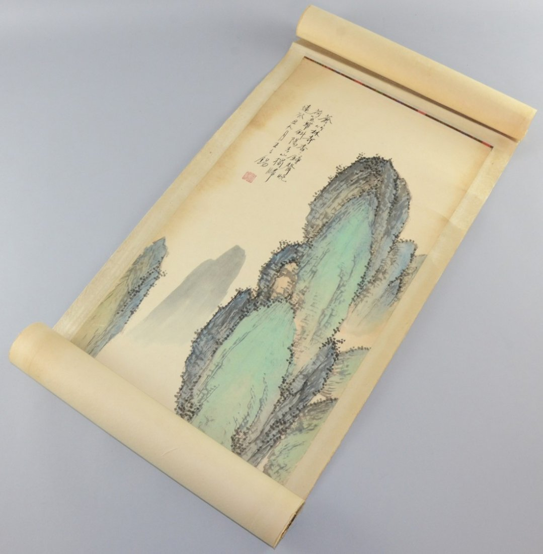 Chinese scroll depicting figures and a small house at