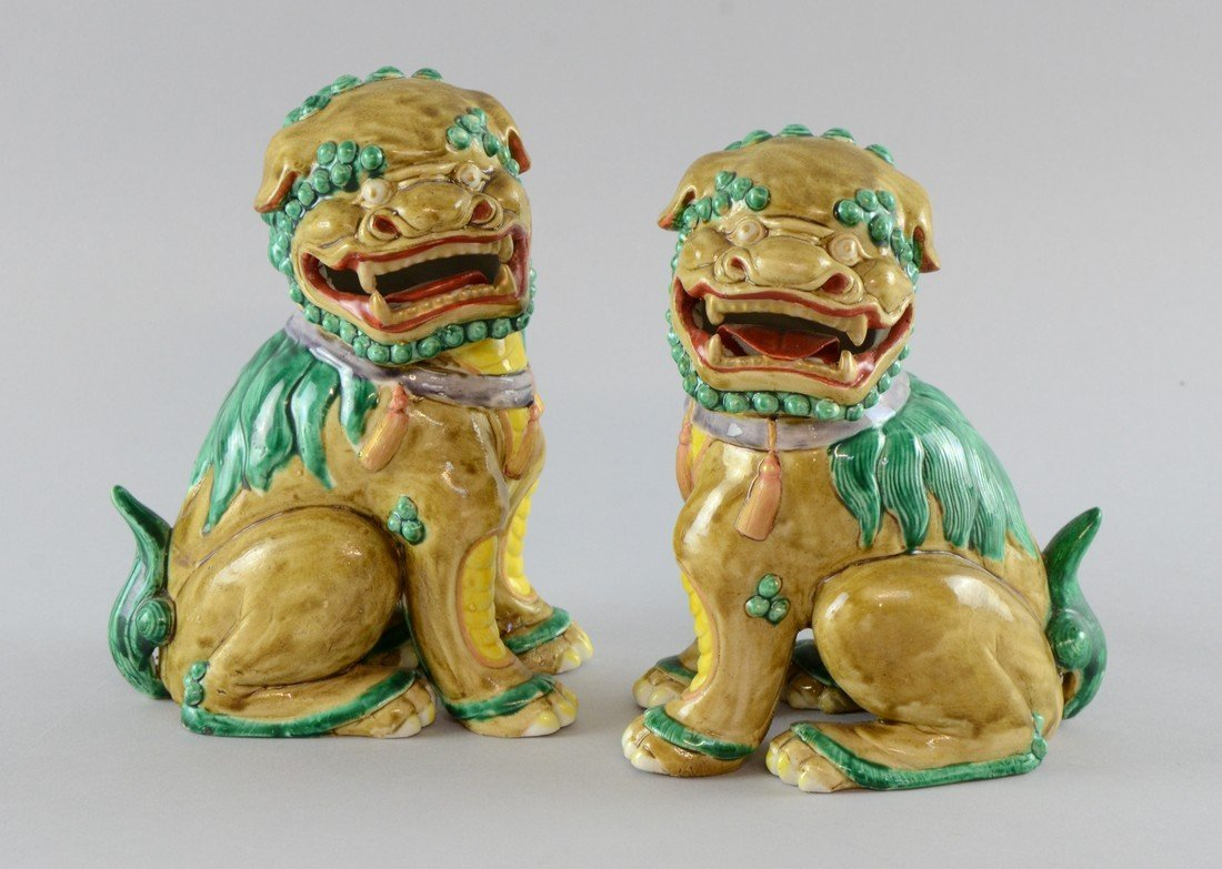 Pair of 20th century Chinese dogs of Fo in green, brown