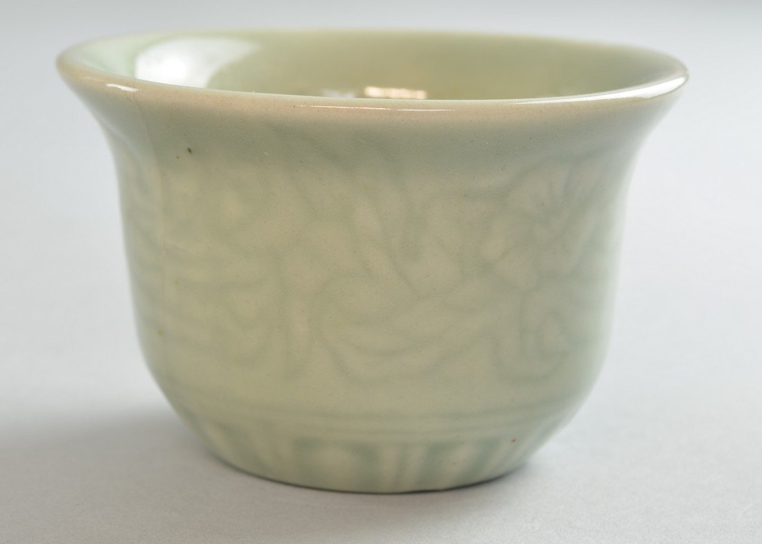 Small Chinese celadon glazed bowl with moulded