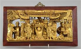 Chinese carved gilt wood panel of figures by an altar,