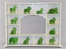 Set of twelve 20th century Chinese green glass beasts
