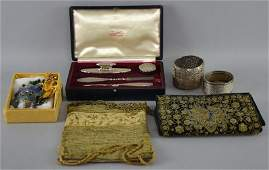 A mixed group of items including a silver manicure set
