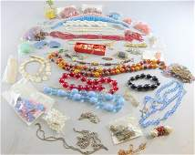 Collection of vintage costume jewellery and loose beads